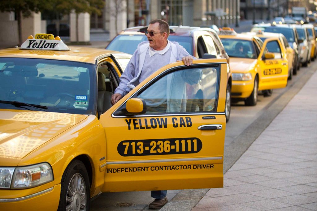Taxi driver Chuck Peto gets in his cab while waiting for a fare on Milam Wednesday, Jan. 29, 2014, in Houston. City officials are considering changes to the regulations permitting taxi and limousine services, following a long-awaited survey on the regional taxi industry. ( Brett Coomer / Houston Chronicle )